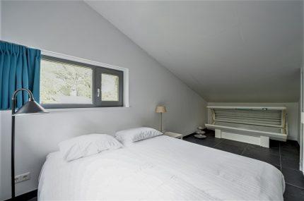 slaapkamer met zonnebank
